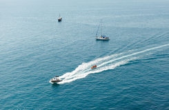 The motor boat sails on the black sea Stock Photo