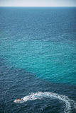 A motor boat in the sea of Menorca, Balearic Islands, Spain Royalty Free Stock Photo