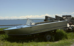 Motor boat on the shore next to Sevan lake Royalty Free Stock Photo
