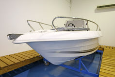 Motor boat in showroom or garage stock images