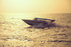 Motor boat on sunset Royalty Free Stock Image
