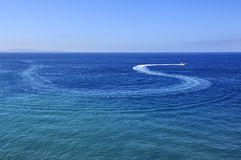 Motor boat trace on blue water Stock Image