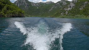Motor boat trail on the water. Slow motion stock video footage