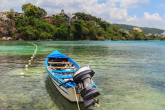 Motor boat in transparent water of Caribbean sea, Jamaica Royalty Free Stock Photos