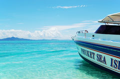 Motor boat on turquoise water of Indian Ocean Stock Image