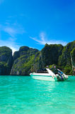 Motor boat on turquoise water of Maya Bay lagoon Royalty Free Stock Photo