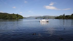 Motor boat Windermere Lake District from Bowness in summer stock video