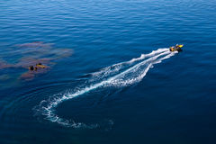 Motor boating on the sea. The trace waves of the fast boats Stock Images