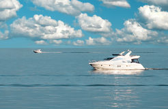 Motor boats-1. Two white motor boats at azure sea Stock Photos