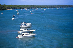 Motor boats anchored close to the shore Stock Image