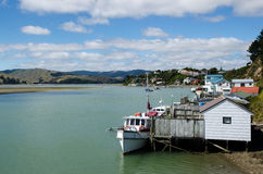 Motor boats and boat sheds Royalty Free Stock Photography