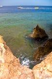 Motor boats, buoys on the sea and rocky coast. Egypt. Shallow de Stock Photography