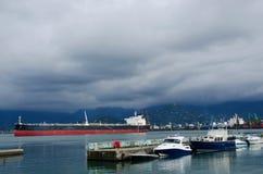 Motor boats and cargo ships at Batumi sea port,Georgia Stock Images