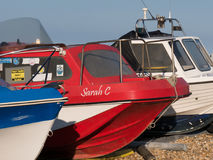 Motor boats at the coast. At the coast with boats, stones on the beach, details for bookcover royalty free stock photos