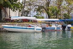 Boats docked in Rio Dulce, Guatemala Royalty Free Stock Images
