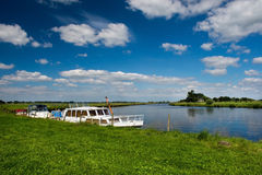 Motor boats in Dutch river. Landscape with Dutch river the Eem and motor boats Stock Photo