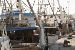 Motor boats for fishing moored at the port.  Stock Image
