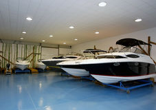Motor boats in hangar royalty free stock image