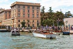 Motor boats near the waterbus stop Ferrovia in Venice, Italy Royalty Free Stock Image