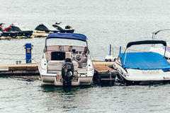 Motor boats parked at the pier Royalty Free Stock Images