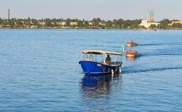 Motor boats with passengers running between banks of Dnepr river. DNEPR, UKRAINE - SEPTEMBER 10, 2016:Motor boats with passengers running between banks of Dnepr stock photos