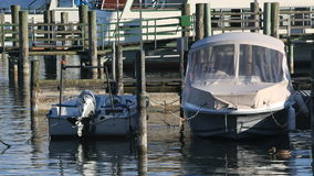 Motor boats at the pier stock video
