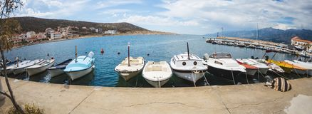 Motor boats on the pier. Sea coast of Croatia. Swimming facilities by the sea. Yachts and sailboats in the port. Fishing boats royalty free stock image