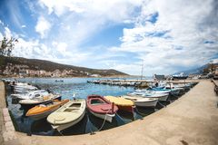 Motor boats on the pier. Sea coast of Croatia. Swimming facilities by the sea. Yachts and sailboats in the port. Fishing boats royalty free stock photography