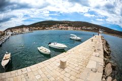 Motor boats on the pier. Sea coast of Croatia. Swimming facilities by the sea. Yachts and sailboats in the port. Fishing boats royalty free stock photos