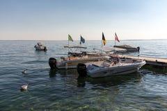 Motor boats at Porto di Bardolino harbor on The Garda Lake Stock Photo
