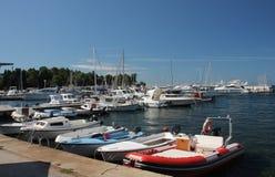 Motor boats and sailboats in harbor in Porec,Croatia. Stock Images