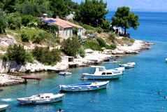 Motor boats in small bay in Mali Losinj. With stonemade house and pine trees Royalty Free Stock Images