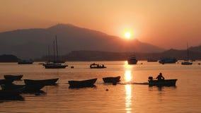 Motor boats at sunset Royalty Free Stock Photo