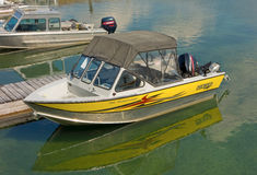 Motor-boats tied to slips at a marina in northern bc Stock Photo