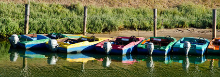 Motor boats. To rent on the river; at the end of day Royalty Free Stock Photos