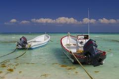 Motor boats in tropics. Two motor boats tied to shore in the tropics Stock Photos