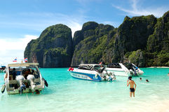 Motor boats on turquoise water of Maya Bay lagoon Stock Images