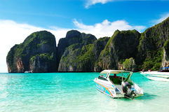 Motor boats on turquoise water in Maya Bay lagoon Stock Photos