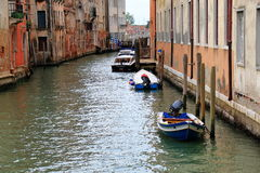 Motor boats on a water in the Venetian canal, Italy Stock Photos