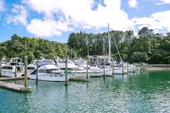 Motor boats, yachts and launches moored in front of a building a Royalty Free Stock Photos