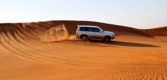 Motor car in desert. Side view of off all terrain motor car driving across sandy desert Stock Photos