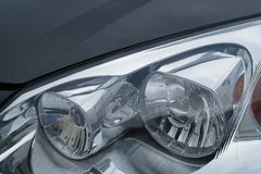 Motor car headlamps Stock Image
