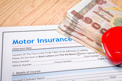 Motor or car insurance application and thai banknotes money form Stock Images