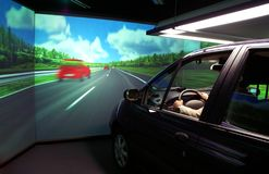 Motor-car simulator for ergonomics research. Motor-car simulator for drivers training and ergonomics research, 3D-visualizer and real functioning vehicle Royalty Free Stock Photography