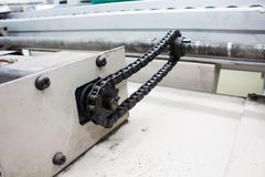 Motor chain drive shaft in conveyor line Stock Photos