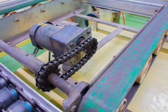 Motor chain drive shaft in conveyor line Royalty Free Stock Images