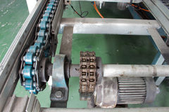 Motor and chain drive shaft Line Conveyor Industrial Royalty Free Stock Photography