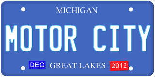 Motor City Michigan. An imitation Michigan license plate with December 2012 stickers and Motor City written on it making a great Detroit or Michigan auto concept Stock Photo