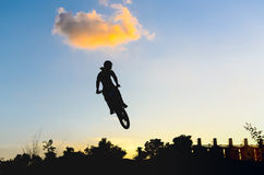 Motor Cross with silhouette Royalty Free Stock Photos