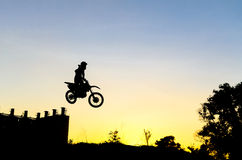 Motor Cross with silhouette Stock Images